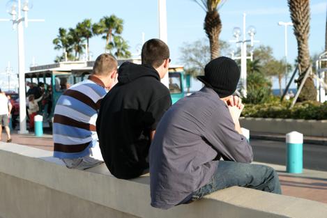 bigstockphoto_Teenaged_Boys_On_Wall_77745[